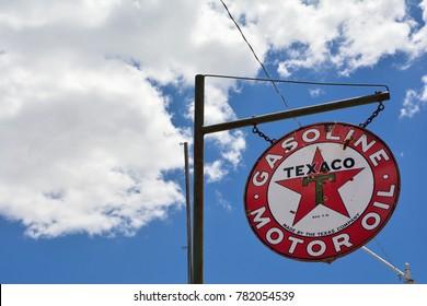 """Oklahoma, Usa - July 20, 2017: Texaco Sign. Texaco, Inc. (""""The Texas Company"""") is an American oil subsidiary of Chevron Corporation."""