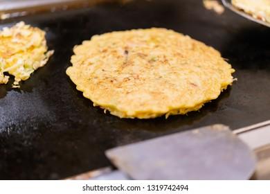 Okonomiyaki grilled with iron plate