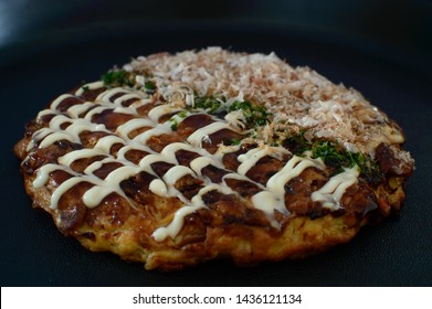 Okonomiyaki is a Japanese savory pancake containing a variety of ingredients. It is mainly associated with the Kansai or Hiroshima areas of Japan, but is widely available throughout the country.