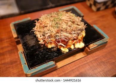 Okonomiyaki in Osaka, Japan - Japanese food / Savory Pancake