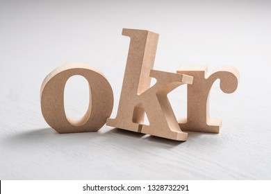 OKR wood alphabet letters on the table, the acronym of Objective Key Results