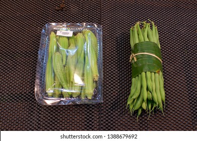 Okra bundled in a plastic package and beans wrapped in Banana leaf. This is an excellent solution how replace plastic packaging and reduce the waist of it - Bali, Indonesia