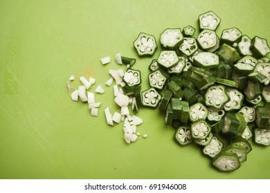 Okra and garlic cut into small pieces; shot from above