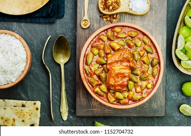 Okra stew topped with chunk of beef and served with white rice, fresh pita bread and lemon. It,s traditional Egyptian,Greek,Turkish and Romanian dish.