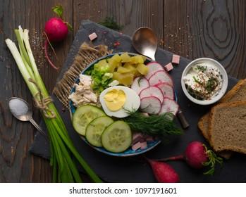 Okroshka, Ingredients for preparing the cold soup okroshka, wooden background, russian food