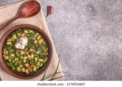 Okroshka with kvass and fresh vegetables,  top view with copy space. Traditional Russian meal