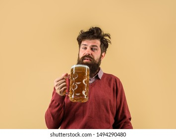 Oktober fest. Barman. Brewer. Oktoberfest festival. Tasting fresh brewed beer. Brewer holds glass with craft beer. Brewery concept. Man with beer of mug. Alcohol. Male brewer holds glass with beer.