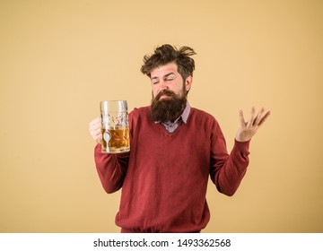 Oktober fest. Male brewer holds glass with beer. Tasting fresh brewed beer. Brewer holds glass with craft beer. Brewery concept. Oktoberfest festival. Alcohol. Man with beer of mug. Barman. Brewer.