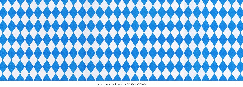Oktoberfest background frame with bavarian white blue paper, banner. October fest background, text place, copy space. Bavaria State flag fabric table cloth. Oktoberfest cloth paper runner
