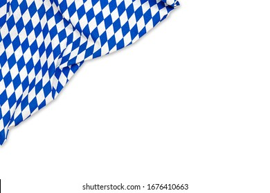 Oktoberfest background frame with bavarian white blue fabric, isolated on white. October festival background, text place, copy space. Bavaria State flag fabric table cloth