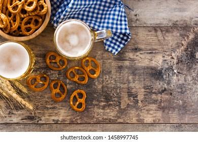 Oktoberfest beer and pretzel on wooden table. Top view. Copyspace
