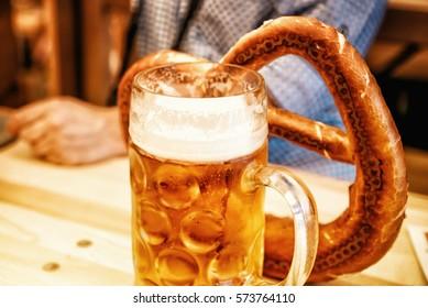 Oktoberfest beer and pretzel on wooden table