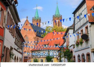 Oktoberfest decoration in the streets of old German town. Old frame houses in german medieval city. Street with traditional Houses and Oktoberfest garland