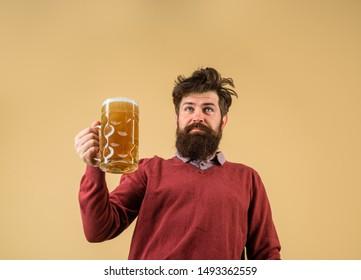 Oktoberfest festival. Alcohol. Male brewer holds glass with beer. Oktober fest. Tasting fresh brewed beer. Brewer holds glass with craft beer. Brewery concept. Man with beer of mug. Barman. Brewer.