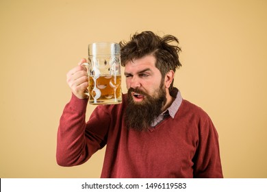 Oktoberfest festival. Brewer holds glass with craft beer. Brewery concept. Man with beer of mug. Alcohol. Male brewer holds glass with beer. Oktober fest. Tasting fresh brewed beer. Barman. Brewer.