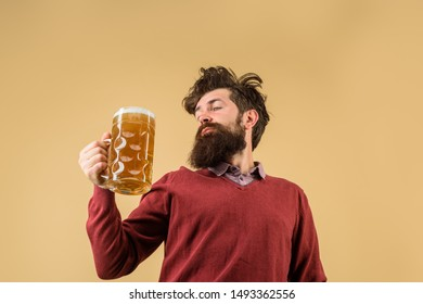 Oktoberfest festival. Brewery concept. Man with beer of mug. Alcohol. Male brewer holds glass with beer. Oktober fest. Tasting fresh brewed beer. Brewer holds glass with craft beer. Barman. Brewer.