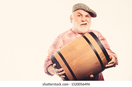 oktoberfest festival. brewery for maturing alcohol. Homemade wine. Man bearded senior carry wooden barrel for wine. Fermentation product. Retro man with a beer barrel. Barman. wooden barrel.