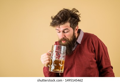 Oktoberfest festival. Tasting fresh brewed beer. Barman. Brewer holds glass with craft beer. Brewery concept. Man with beer of mug. Alcohol. Male brewer holds glass with beer. Oktober fest. Brewer.