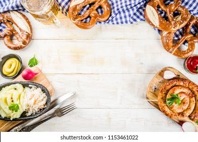 Oktoberfest food menu, bavarian sausages with pretzels, mashed potato, sauerkraut, beer bottle and mug