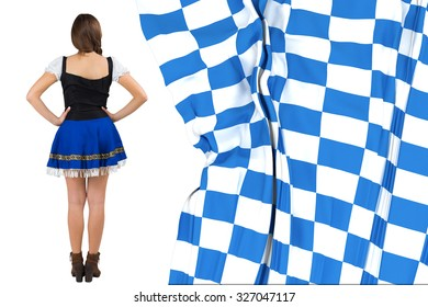 Oktoberfest girl standing with hands on hips against blue and white flag