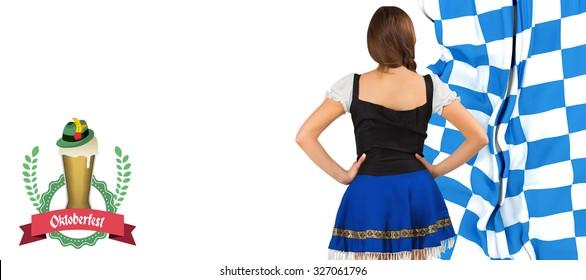 Oktoberfest girl standing with hands on hips against oktoberfest graphics