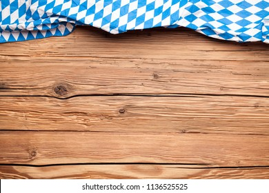 Oktoberfest tablecloth on an old rustic wooden background
