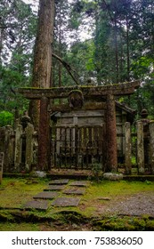 Okunoin cemetery day and night.  Things you see are shrines, jizo, offerings, shinto tori gates, buddha statues, and many more