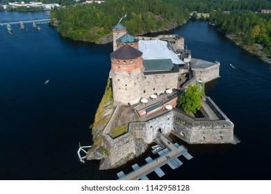 Olavinlinna fortress close-up on a sunny July day (aerial survey). Savonlinna, Finland