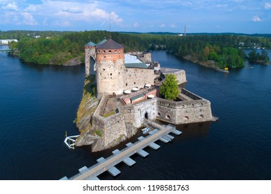 Olavinlinna fortress close-up on a sunny July day (shot from a quadcopter). Savonlinna, Finland