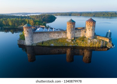 Olavinlinna fortress in the morning summer landscape (aerial photography). Savonlina, Finland