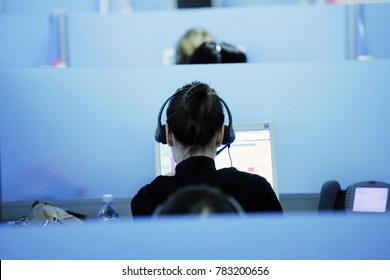 Olbia, Italy - April 6, 2015: Young woman working in call center