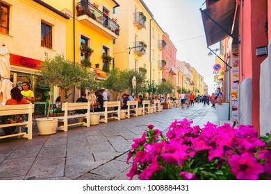Olbia, Italy - September 11, 2017: People at street cafe in Corso Umberto Street in Olbia, Sardinia, Italy