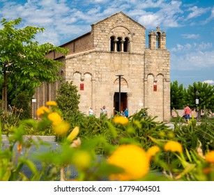 Olbia, Sardinia / Italy - 2014/07/25: XI century medieval Basilica of St. Simplicio - Basilica San Simplicio - at the Piazza San Simplicio square in the historic old town quarter
