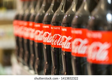 OLCHING, BAVARIA / GERMANY - May 18, 2019: Close up / side view on Coca-Cola bottles. Coca-Cola is brand of the Coca-Cola company. The Coca-Cola writing is a worldwide registered trademark.