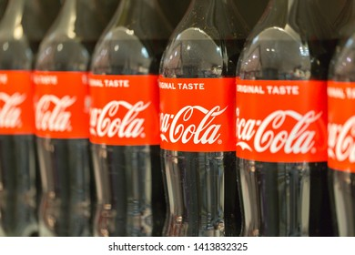 OLCHING, BAVARIA / GERMANY - May 18, 2019: Close up / side view on Coca-Cola bottles. Coca-Cola was invented in 1886. The brand Coca-Cola is owned by the Coca-Cola company.
