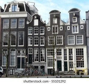 Old 17th and 18th century brick houses along the canals in Amsterdam in the Netherlands