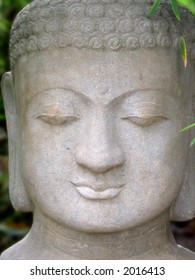 Old (18th C) stone sculpture depicting face of Buddha. This big, peaceful face is very comforting.