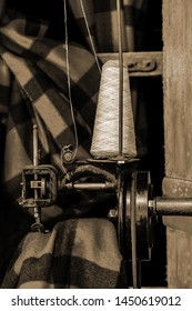 Old 1900s Woolen Mill Machinery and Sewing Yarn into Fabric in sepia tone