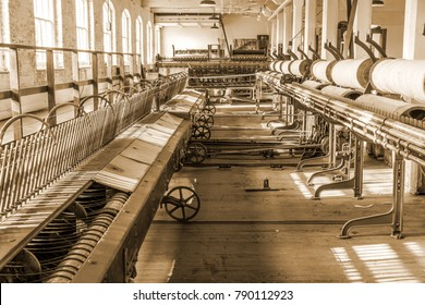 Old 1900s Woolen Mill Machinery and Manufacturing in Sepia Tone.