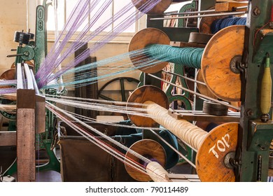 Old 1900s Woolen Mill Machinery and Manufacturing Different Colored Yarn in Fabric Design.