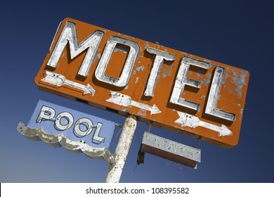 Old 1950's neon sign reading Motel Pool in remote part of desert of Arizona