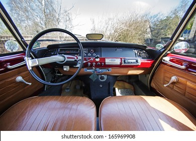 Old 1970s French car Citroen interior - panel drive - in red.