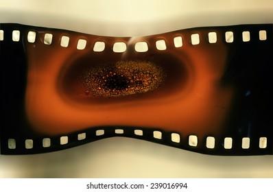 old 35 mm film burnt and melting