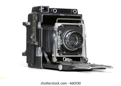 Old 4x5 film camera on white background, used mainly in the 1940's.