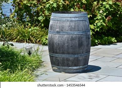 Old 55-gallon Wine Barrel on Brick Path