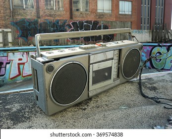 Old 80's boom box stereo by an abandoned pool - landscape photo