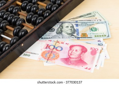 Old abacus with chinese yuan us dollar banknote