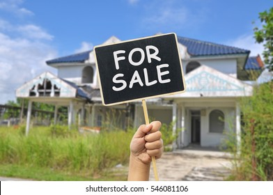old abandon house with placard write for sale