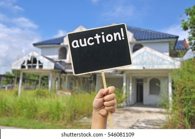 old abandon house with placard write auction