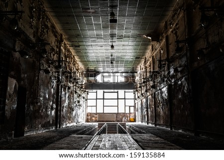 old abandon industrial construction interior, polishing workshop
